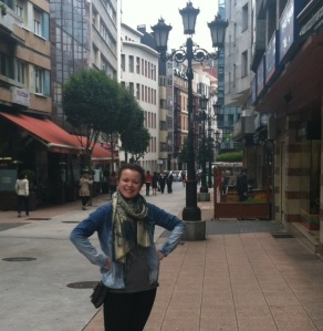 "This is my daughter, Erica, posing ""on the street where we live"".  We have a charming little hotel with great decor, friendly staff and an ideal location in Oviedo."