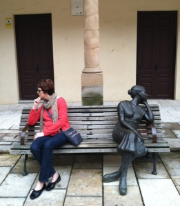 Oviedo is known for its statues.   Here I am sitting on a bench with a friend.